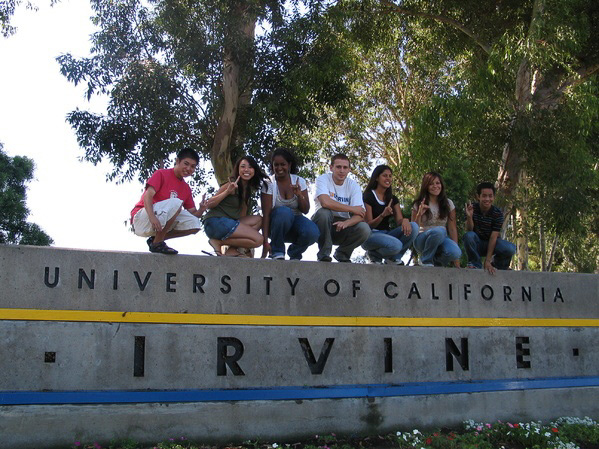 students-standing-on-UC-Irvine-sign